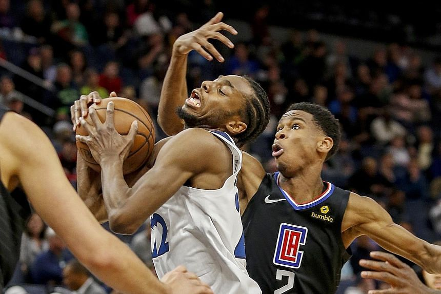 Minnesota Timberwolves forward Andrew Wiggins driving to the basket against the Los Angeles Clippers' Shai Gilgeous-Alexander during the Clippers' 122-111 win on Tuesday. The Clippers became the fifth team in the Western Conference to clinch a play-o