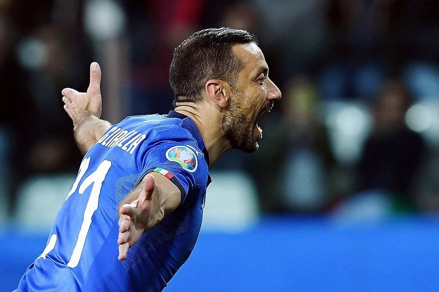 Italy's Fabio Quagliarella, 36, celebrating after scoring in the Euro 2020 qualifying win over Liechtenstein on Tuesday. He netted a brace in a 6-0 victory to bring his total to nine goals for his country.