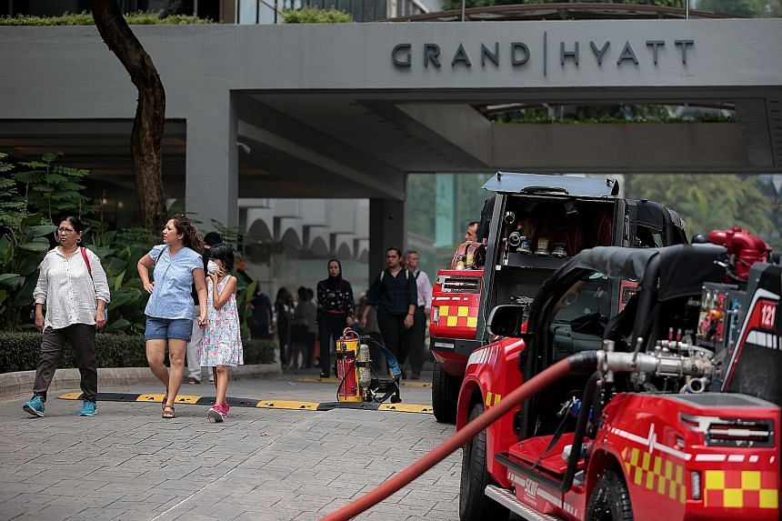 Clockwise from left: About 500 people were evacuated after the fire broke out. At least three Singapore Civil Defence Force vehicles were at the scene. The fire started in the kitchen of Mezza9, on the second floor.