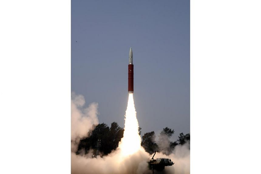 The launching of an interceptor missile from the A P J Abdul Kalam Island in Odisha, India, during an anti-satellite missile test, on March 27, 2019.