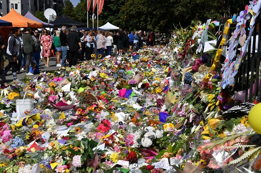 Flowers and tributes at a makeshift memorial to commemorate victims of the Christchurch mosque attacks, on March 19, 2019.