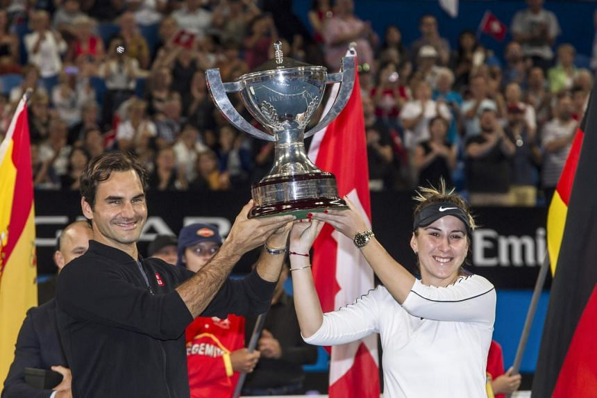 Roger Federer and mixed doubles partner Belinda Bencic holding the Hopman Cup during the tournament in Perth, on Jan 5, 2019.