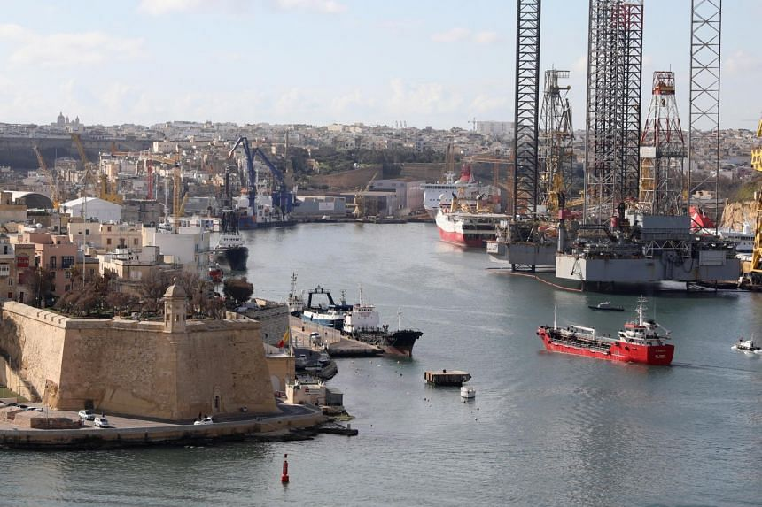 The merchant ship Elhiblu 1 being guided into a harbour in Malta after being retaken by Maltese Armed Forces on March 28, 2019.