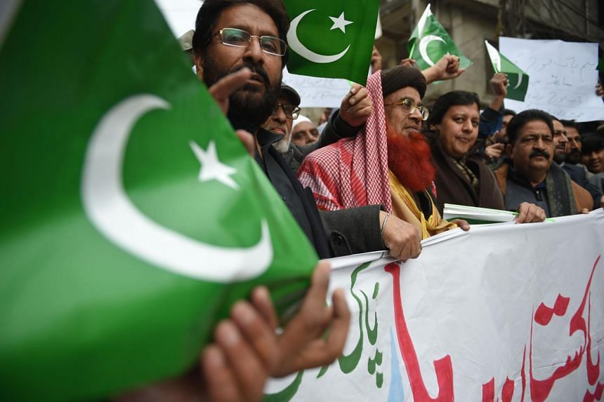 Pakistani men march in support of the Pakistan army during an anti-India protest in Rawalpindi, on March 1, 2019.