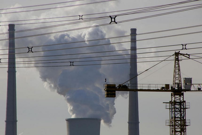 A coal-fired power plant is pictured near a construction site in Beijing, China.