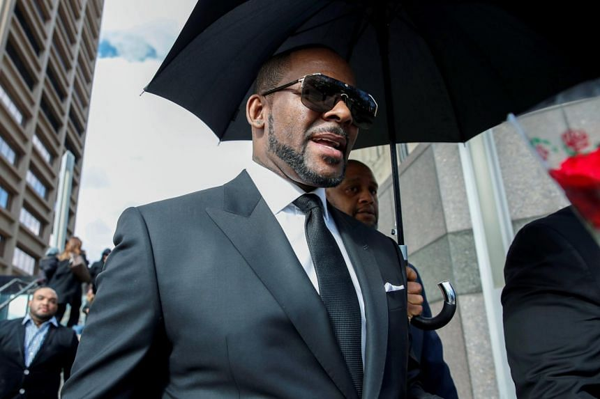 R. Kelly leaving the Cook County courthouse after a hearing on multiple counts of criminal sexual abuse case, in Chicago, Illinois, on March 22, 2019.