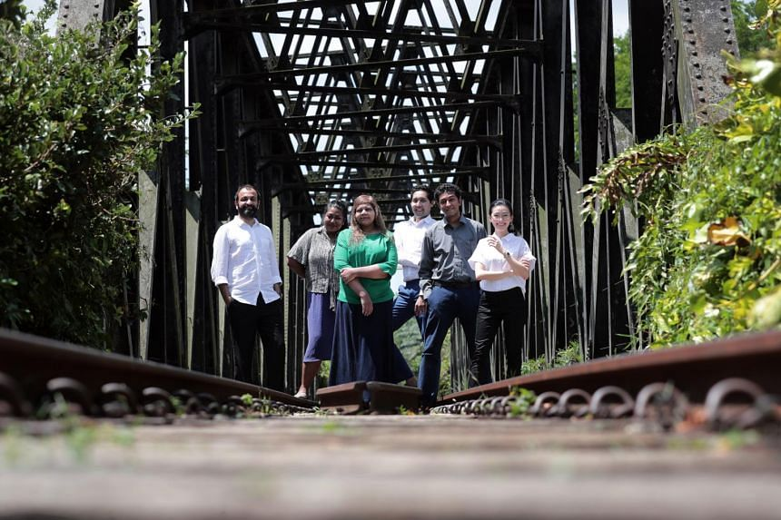 Writer Sharmila Yogalingam (in green) with the cast of Railway Records at the black truss bridge near the old Bukit Timah Railway Station.
