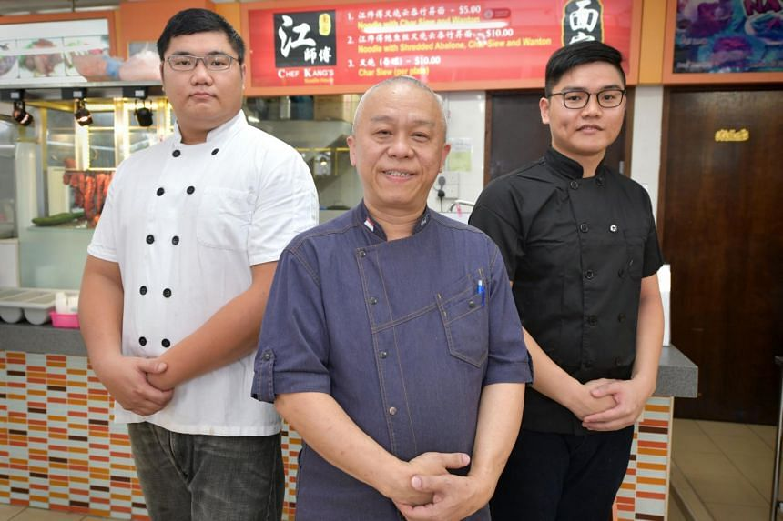 Chef Ang Song Kang his proteges Benson Moo (in white), 29, and Winson Moo, 25.