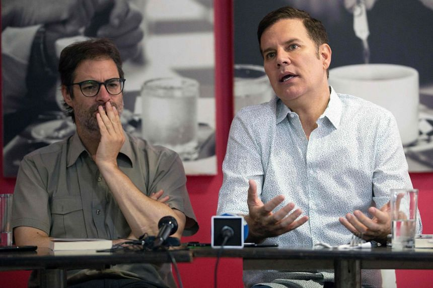 Jose Andres Murillo (left) and Juan Carlos Cruz attend a press conference in Santiago in January 2019.