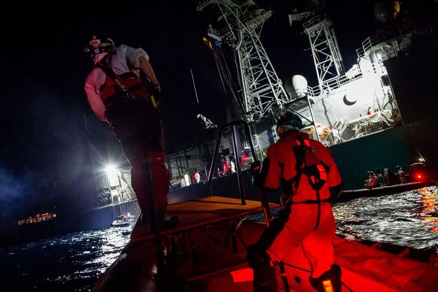 A Spanish warship helps to rescue migrants in the Mediterranean sea in 2017.