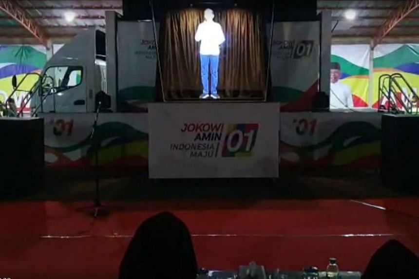 Indonesian President Joko Widodo has a tight schedule so he and his vice-presidential running mate are projecting three-dimensional images of themselves at some campaign rallies.