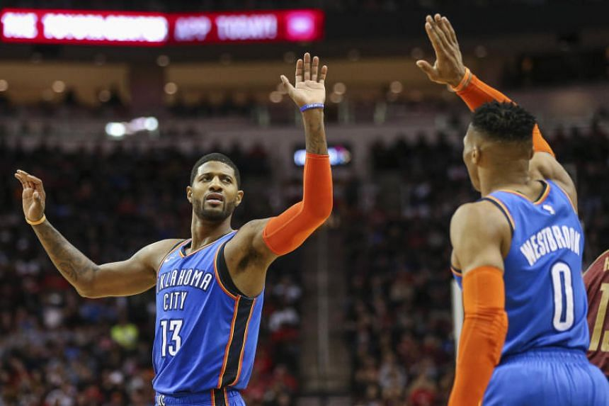 Oklahoma City Thunder's Paul George (left) led the scoring in the 107-99 victory over the Indiana Pacers, while Russell Westbrook finished with 17 points, 11 rebounds and 12 assists to claim his 29th triple double of the season.