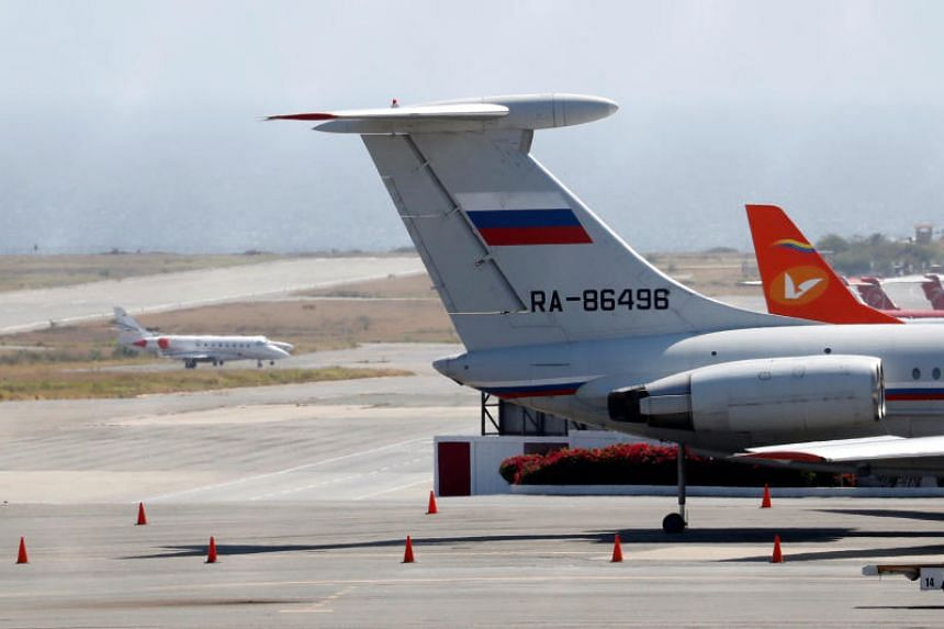 A plane with the Russian flag at Simon Bolivar International Airport in Caracas on March 24, 2019. Russia has deployed troops and equipment to bolster Venezuelan President Nicolas Maduro.