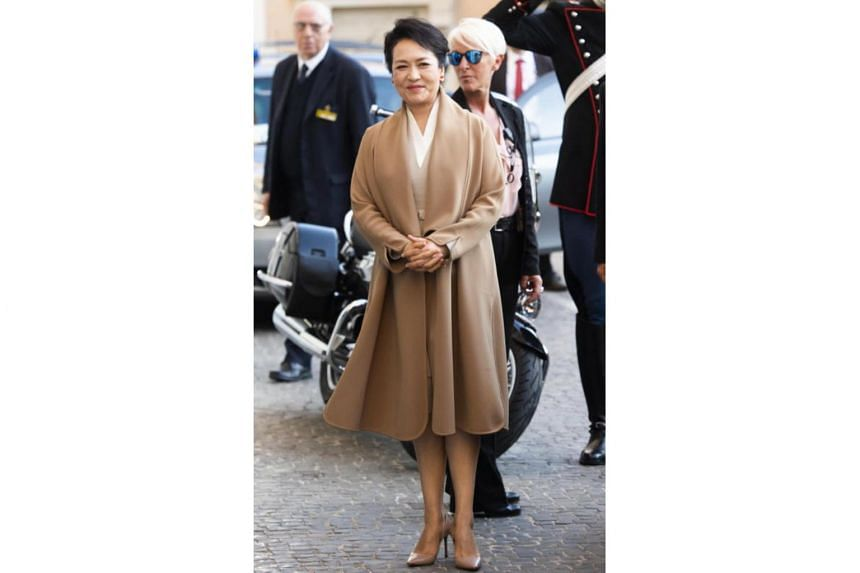 China's First Lady Peng Liyuan leaves Palazzo Colonna (Colonna Palace) after her visit, in Rome, Italy, on March 22, 2019.
