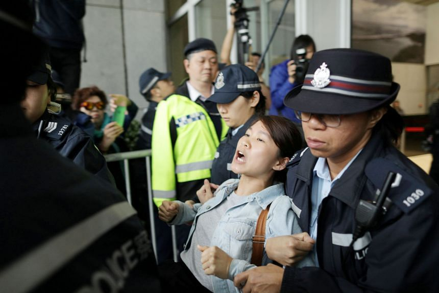 A protester being arrested by the police after storming the Hong Kong government's headquarters earlier this month over proposed changes to the city's extradition laws. After local and foreign business chambers, among others, called on the government