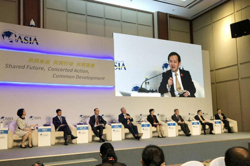 A panel discussion on China's services sector at the Boao Forum in Hainan yesterday. The panellists said conditions at the local level remain challenging despite unprecedented reforms to liberalise the market at the national level.