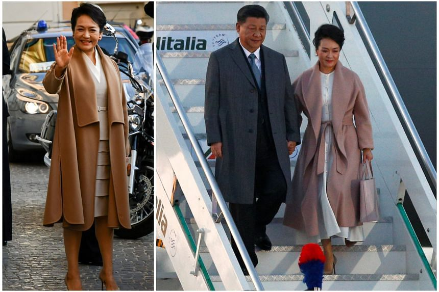 Ms Peng Liyuan wearing a lilac belted shawl lapel coat (right) when she stepped off the plane in Rome and in a camel coat (left) with a similar silhouette when visiting Palazzo Colonna.