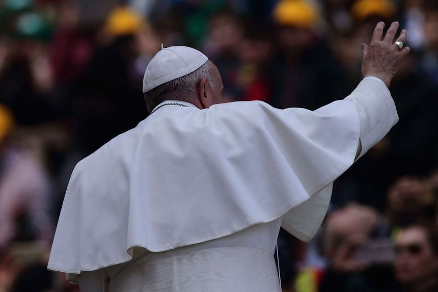 Pope Francis arrives to lead his weekly general audience in St Peter's Square.
