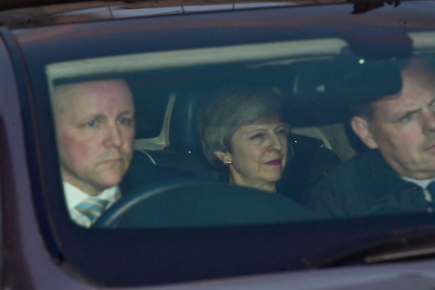 Theresa May (centre) leaves the Houses of Parliament after telling Conservative MPs that she will not be leading the next phase of the Brexit negotiations.