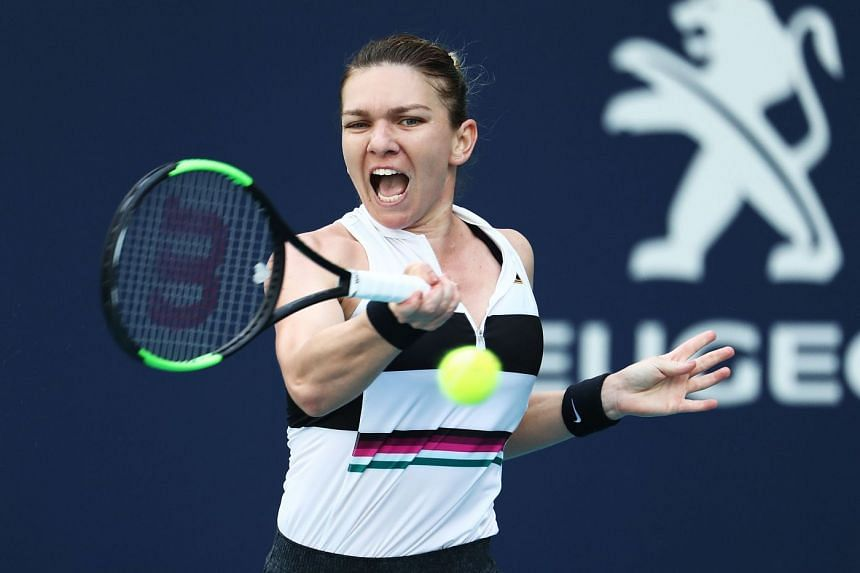 Halep plays a point against Qiang Wang of China.