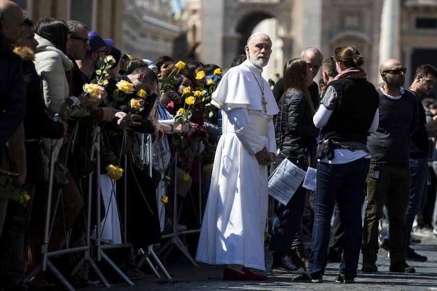 Malkovich in papal vestments during filming for The New Pope in Rome, Italy.