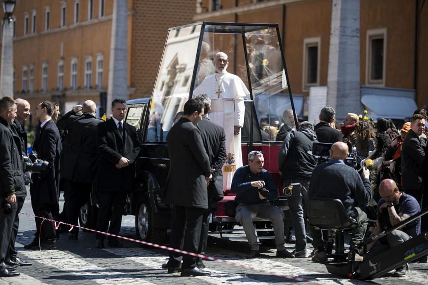 Malkovich in papal vestments filming The New Pope in Rome, Italy.