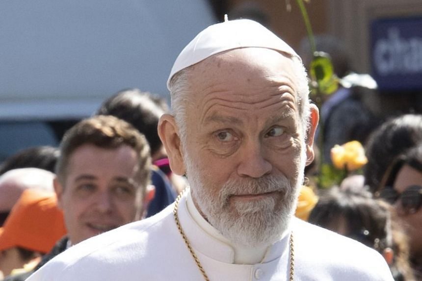 Malkovich wears papal vestments during the filming of the television series The New Pope.
