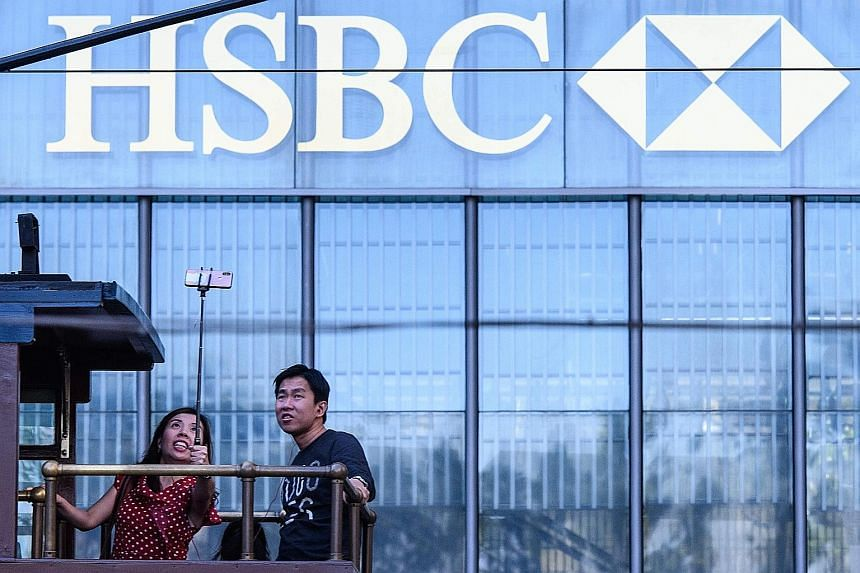 HSBC and Standard Chartered Bank are among banks most at risk from the competition posed by virtual banks, according to Goldman Sachs Group. About 30 per cent of Hong Kong's banking revenue is up for grabs.