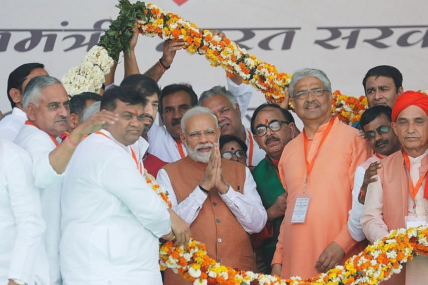 Lots of colour and festivities as Prime Minister Narendra Modi (centre) meets party supporters at a campaign rally in Meerut, in the northern state of Uttar Pradesh.