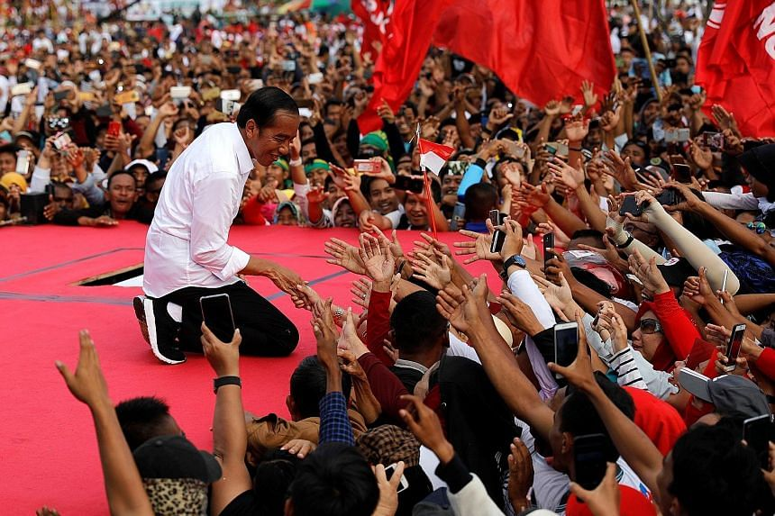 "Mr Prabowo Subianto speaking at his rally in Bandung, West Java, yesterday. He called on his ""brothers"" in the province to hand him and his running mate Sandiaga Uno a resounding victory in the April 17 elections. Indonesia President Joko Widodo at a"