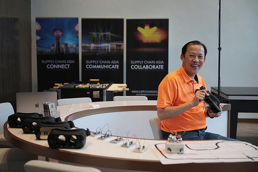 Supply Chain Asia president Paul Lim with some of the gadgets being tested for the industry at the Trade Association Hub in Jurong earlier this week. Start-ups have already come up with ideas that can impact the sector, with innovations like high-tec