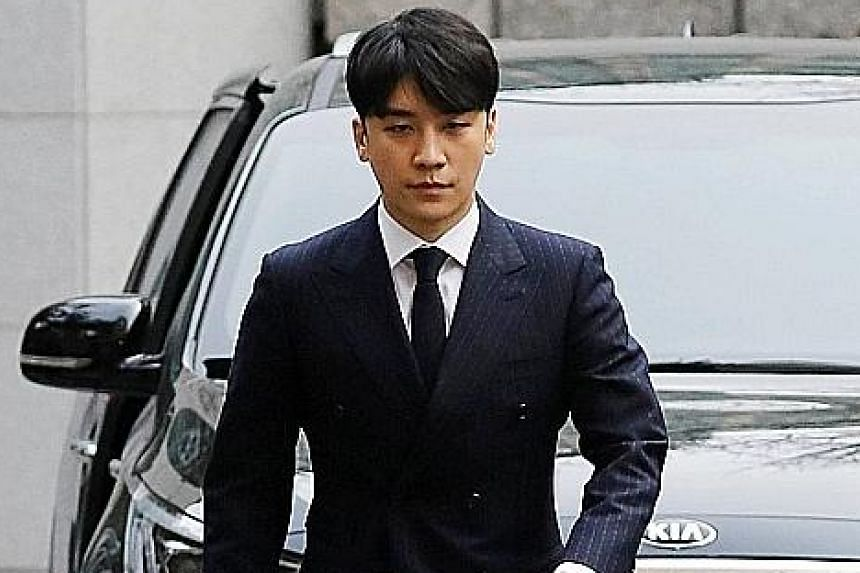 Seungri arriving at the Seoul Metropolitan Police Agency for questioning on a sex bribery case earlier this month.