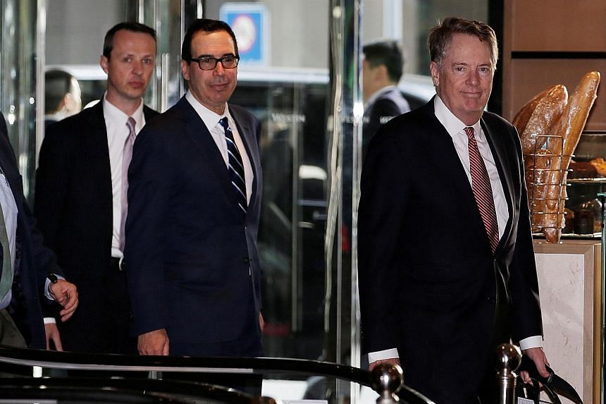 """US Treasury Secretary Steven Mnuchin (middle) and US Trade Representative Robert Lighthizer (right) arriving in Beijing yesterday for a new round of trade talks. The duo and China's top economic official Liu He have """"made some progress"""" on trade afte"""