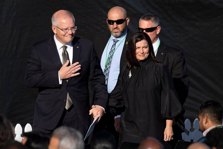 Australian PM Scott Morrison (left) with his wife Jenny arrive at the national remembrance ceremony at North Hagley Park in Christchurch, on March 29, 2019.