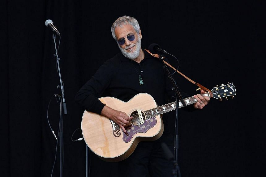 Yusuf Islam, also known as Cat Stevens, performing at the national remembrance ceremony.