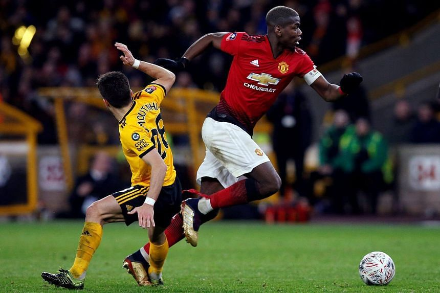 Manchester United's Paul Pogba in action with Wolverhampton Wanderers' Joao Moutinho on March 16, 2019.