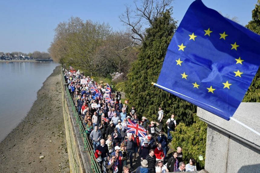 About 1,000 people gathered at Bishop's Park on the bank of the River Thames on the day that Britain was originally meant to be leaving the EU.
