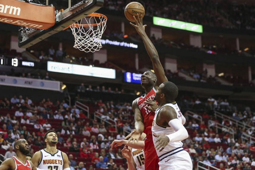 Houston Rockets center Clint Capela shoots against the Denver Nuggets during the first quarter at Toyota Center.