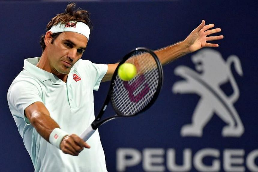 Roger Federer of Switzerland returns a shot during the men's quarter-finals at Miami Open.