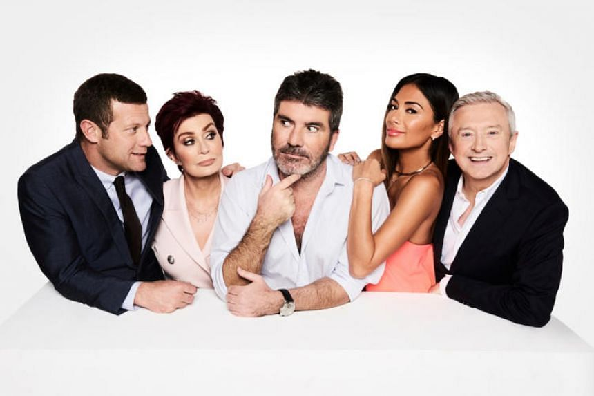 The X Factor UK 13 (from left) host Dermot O'Leary and judges Sharon Osbourne, Simon Cowell, Nicole Scherzinger and Louis Walsh. Osbourne announced several months back that she was leaving the show.