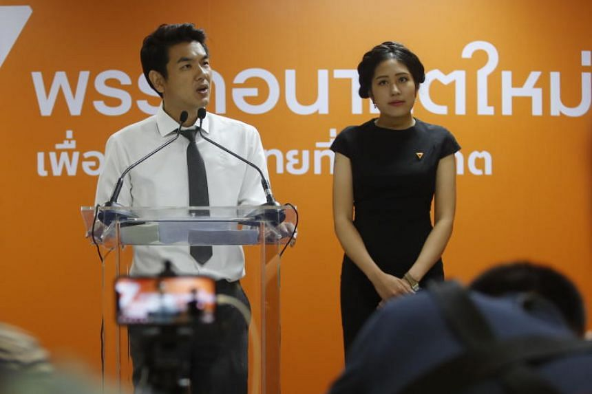 Thai Future Forward Party Secretary-General Piyabutr Saengkanokkul (left) and party spokesman Pannika Wanich address the media during a press conference at the party's headquarters in Bangkok, on March 27, 2019.