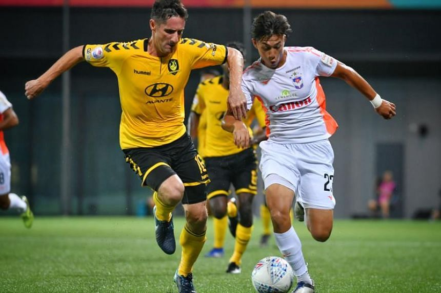 Tampines Rovers' Daniel Bennett (left) defends against Albirex Niigata's Daniel Martens in the Singapore Premier League match played at Our Tampines Hub on March 29, 2019.