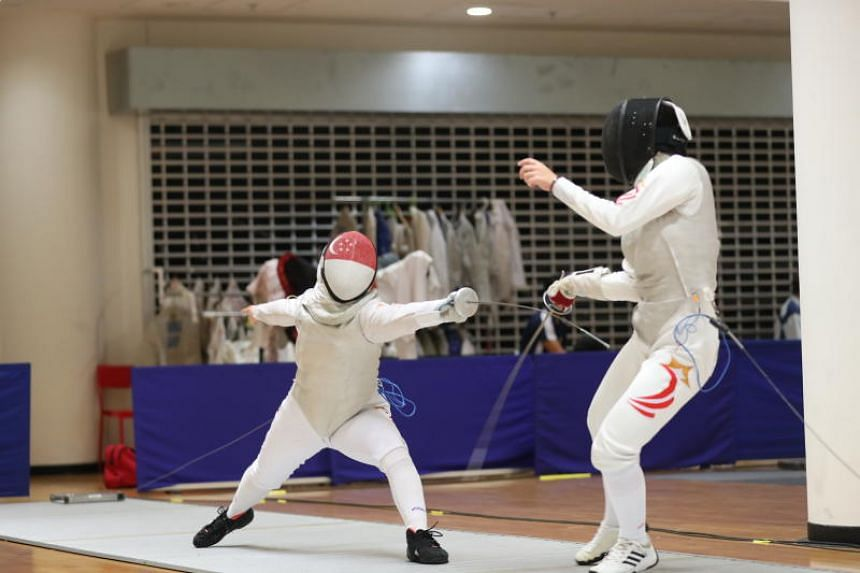 Maxine Wong (left) beat fellow Raffles Institution and national teammate Rachel Lim in the Schools National Fencing Championships A division foil event on March 28, 2019.