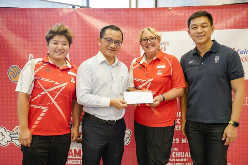 Singapore Gymnastics general manager Karen Norden receiving the scholarship on behalf of Tamara Ong from NTUC FairPrice chief executive Seah Kian Peng, Singapore National Olympic Council president Tan Chuan-Jin and YOG chef de mission Tao Li.
