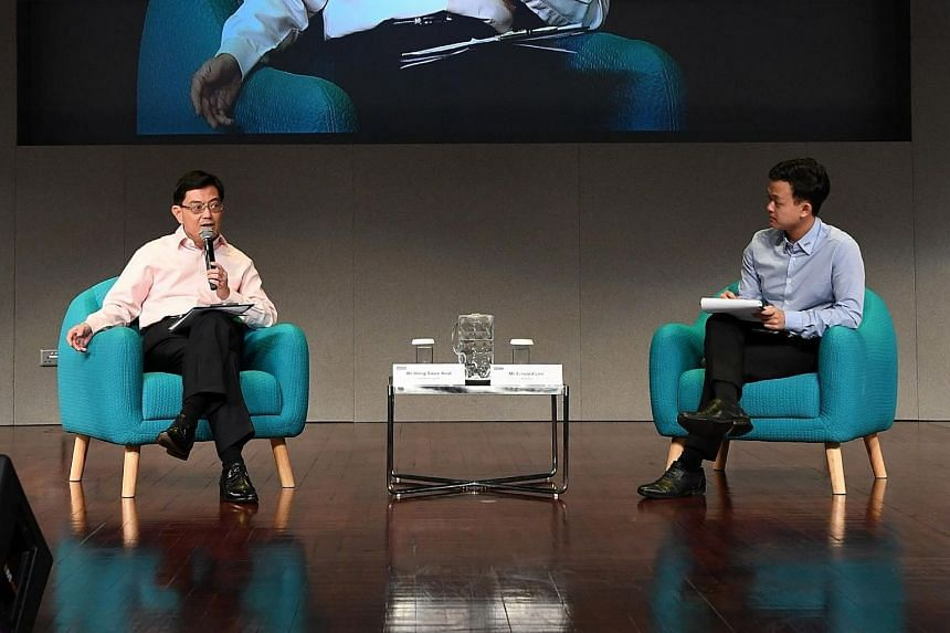 Finance Minister Heng Swee Keat with NTU Students' Union president Edward Lim, who was the moderator at a ministerial dialogue at Nanyang Technological University.