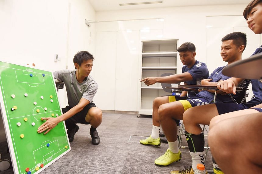 Tampines Rovers' head coach-in-waiting Gavin Lee discussing tactics with his players as they prepare for today's SPL match against Albirex Niigata.