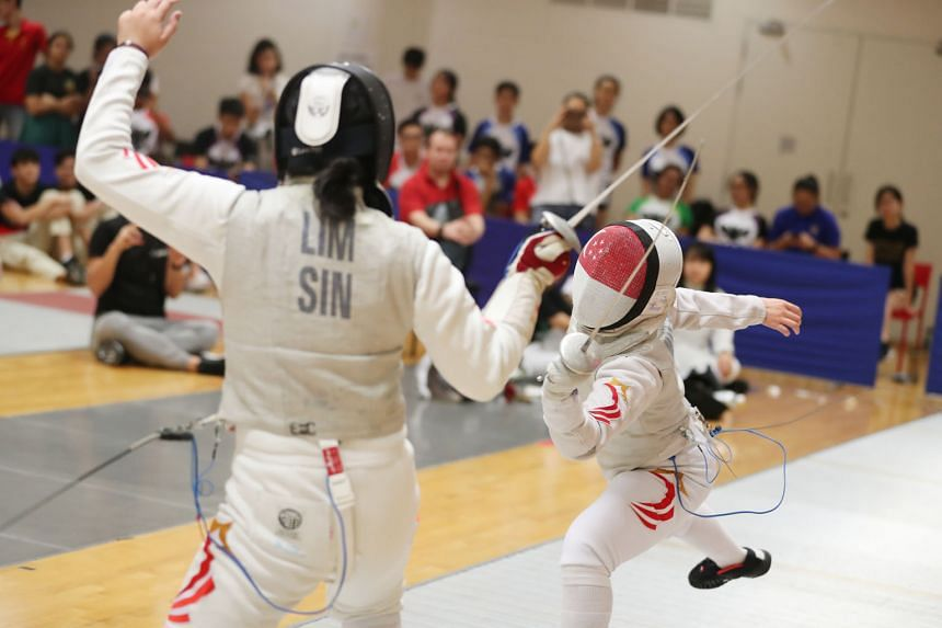 Maxine Wong, 18, on the attack against her national and RI teammate Rachel Lim, 16, in the A Division girls' foil final at the OCBC Arena. She raced to a 10-2 lead after the first round and closed off the bout 15-5.