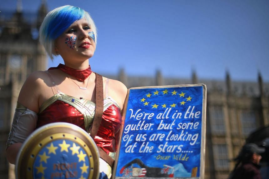 An anti-Brexit supporter demonstrates in front of Parliament, where MPs were voting on a Brexit agreement.