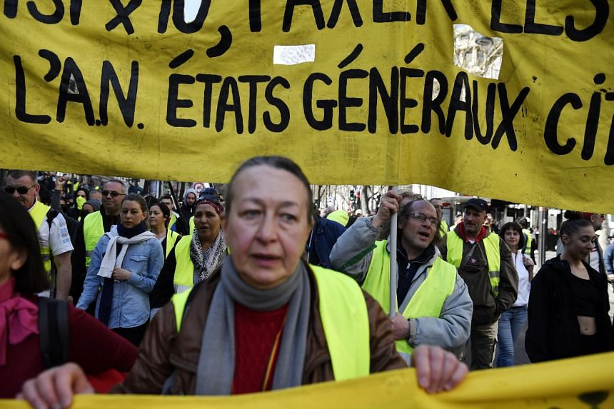 "Yellow vest protesters gather during the ""Act XX"" demonstration (the 20th consecutive national protest on a Saturday) in Paris."