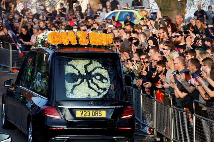 Fans gather for Flint's funeral in Braintree, Essex.